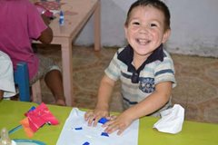 Smiling little boy from our family strengthening programme (photo: SOS archives)