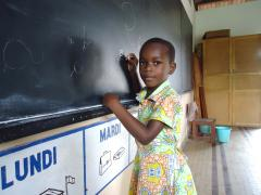 This little girl is able to go to school thanks to SOS Children's Villages (photo: SOS archives)