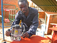 Gladson working at SOS Medical Centre Lilongwe (Photo: Kenneth Nkhonjera)
