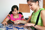 Two girls putting puzzle together (Photo: Katerina Ilievska)