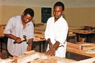 Two students practicing their carpentry skills (Photo: SOS Archives)