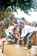 Fresh, clean water from a rehabilitated borehole brings delight and a sense of satisfaction (Photo: SOS Archives)
