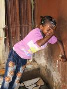 A little girl in our care at the water tap (photo: SOS archives)