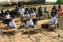 Children playing traditional instruments, SOS Children's Village Dafra - photo: N. Nabiré
