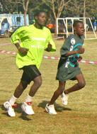 Chikondi on the left and John race towards the finishing line (Photo: Hard Chatsika)