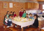 A family at SOS Children's Village Bogotá having breakfast (Photo: SOS Archives)