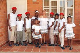 SOS family wearing traditional clothes, SOS Children's Village Cali - photo: SOS Archives