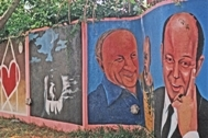 A mural at SOS Children's Village Maputo depicting Hermann Gmeiner and Mr Kutin, painted by Miguel (Photo: J. Dufty)