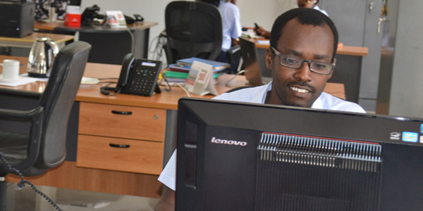 Bienvenu hard at work at the Burundi Revenue Authority. Photo: SOS Archives