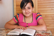 Girl reading a book (Photo: Katerina Ilievska)