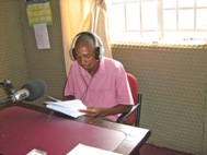 Kingston reporting the news (Photo: Dan Mwatiwamba)