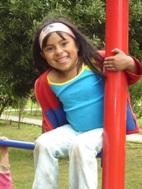 Girl having a good time at SOS Children's Village Bogotá (Photo: SOS Archives)