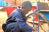 Gladson working on a wheelchair (Photo: Kenneth Nkhonjera)