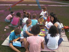 Children enjoying reading outside (photo: SOS archives)