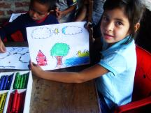 A girl showing the picture she has drawn - Photo: Nuria del Carmen Lorente Centeno