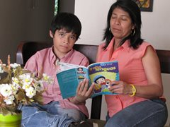 A boy reading with his SOS mother  (photo: SOS archives)