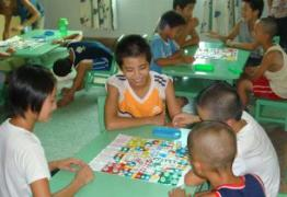 Children playing board games together (photo: SOS archives)