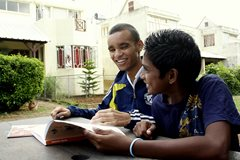 Two young men who are able to go to school thanks to SOS Children's Villages (photo: SOS archives).