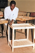 A student with a tea trolley he has made (Photo: SOS Archives)