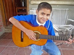 Boy playing the guitar - photo: SOS archives