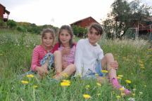 Girls love sitting in the grass fields of the village (Photo: Katerina Ilievska)