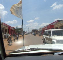People go about their business safely in Gulu - main street seen from the SOS vehicle - Photo: H. Atkins