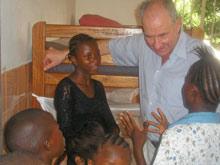 Children invited Mr Don McKinnon to visit their room - Photo: SOS Archives