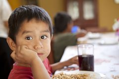 Young boy having lunch (photo: P. Wittmann)