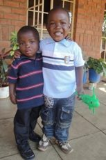 Brothers growing up together in the care of SOS Children's Villages (photo: SOS archives).