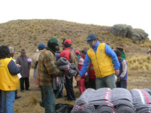 SOS co-workers distributing supplies - Photo: SOS Archives