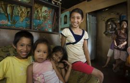 A family being together in their living room - SC/FSP Tacloban