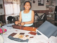 A teenager from SOS Children's Village Sucre shows her works of leather engraving and decorating (Photo: SOS Archives)