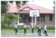 Playing basketball in their school uniforms (photo: SOS archives)