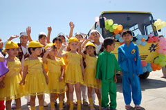 Some of the little inhabitants of the SOS Children's Village Samarkand with their new bus - Photo: M. Mägi