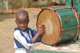 Young boy playing the drum - photo: A. Gabriel