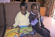 Two children reading a book (Photo: SOS Archives)