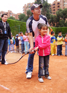A girl from SOS Children's Village Bogotá is taught how to hit a tennis ball (Photo: SOS Archives)