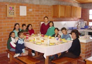 A family at SOS Children's Village Bogotá having breakfast (Photo: SOS Archives)