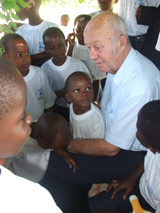 Mr Kutin chats to the children before he leaves the village - Photo: H. Atkins