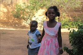 Brother and sister holding hands, SOS Children's Village Ouagadougou - photo: SOS Archives