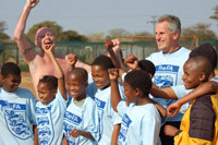 Paul Gascoigne (left) and Ray Clemence with their friends from Tlokweng - Photo: Mark Hooper/The FA