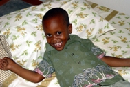 A little boy checks out his new bed (Photo: C. Mukuho)