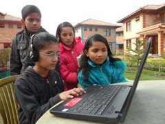 Children learning to use a computer at the children's village (photo: SOS archives)