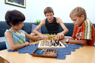 Learning how to play chess with her SOS brothers (Photo: Senad Gubelic)