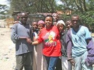 Social worker Fausta Mwili of SOS Social Centre Nairobi with local street children (Photo: H. Atkins)
