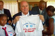 Mr Blatter holding SOS Children's Villages/FIFA t-shirt - Photo: SOS Archives