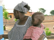 SOS mother with her little charges at SOS Children's Village Kankan - Photo: SOS Archives