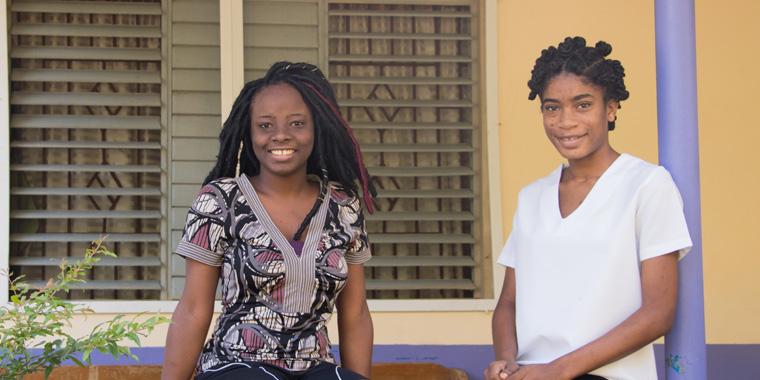 Paula (left) and Natalie, Barrett Town, Jamaica. Photo: Alejandra Kaiser.