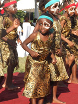 Children from the new village performed impressive traditional dances - Photo: H. Atkins