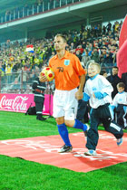 Ronald De Boer with an SOS escort kid at the charity match in Cluj - Photo: K. Ilievska